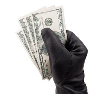 black glove holding hundred dollar bills