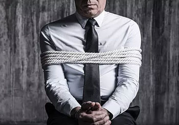 Kidnapped man in ropes