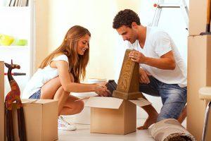 Man and Woman unpacking