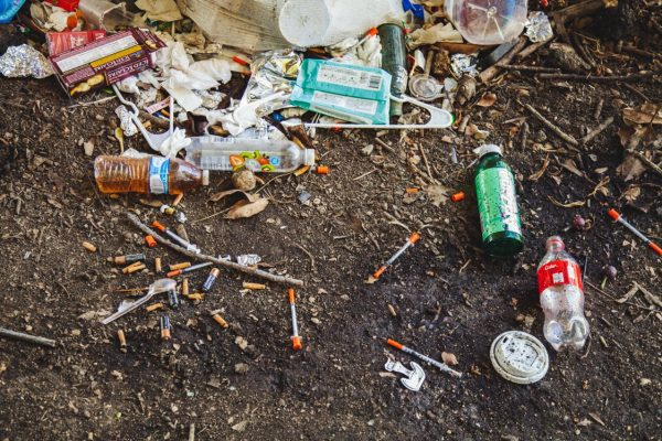 opioid bottles and needles all over the ground